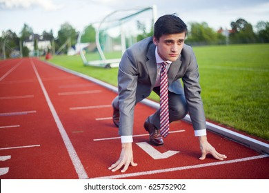 The running path to success. Here you see a successful man on its way to financial freedom. A red running track which is the ladder to the goal of the career.  A man neat, smart and with suit.