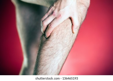 Running physical injury, leg pain. Runner sore body after exercising. Man having pain in muscle.