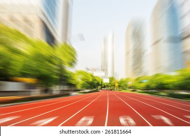running race line in modern city road with cityscape as background,Modern business competition concept.