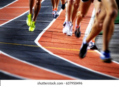 Running a race on a track for sports competition and winning