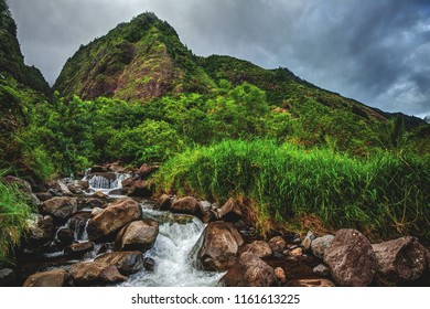 Running River/Waterfall through the jungle in Iao Valley State Park, tucked behind the city of Kahului on the island of Maui, Hawaii.