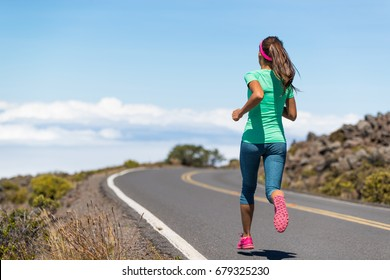 Running runner woman on run goal challenge. Fitness girl training cardio on road to success.