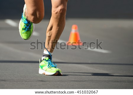 Running shoes, feet and legs close up of runner jogging in action and motion