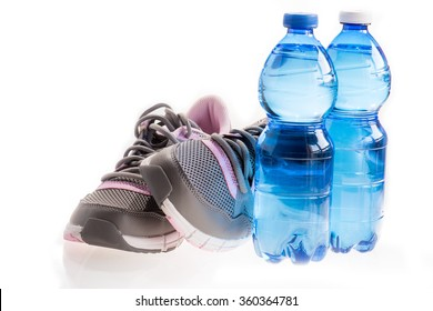 Running shoes witn a water bottle in white background