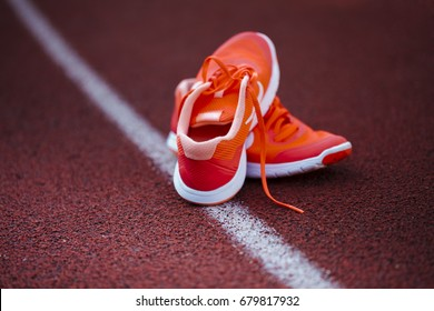 running shoes for wommen on a racetrack