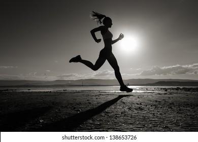 Running silhouette girl
