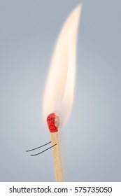 Running single match with burning head. Fire, ignition concept