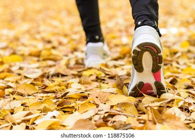 Running sport concept .Closeup of woman barefoot runner shoes. Female jogging on autumn. Copyspace.