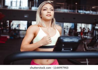 Running in a sports club on a treadmill