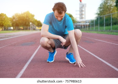 Running sportsman feeling pain after having an injury