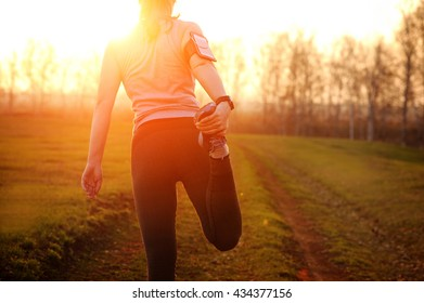 Running stretching - runner wearing smartwatch