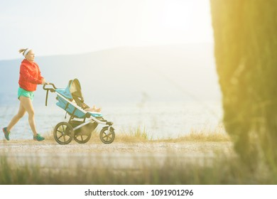 Running super mother with child in baby stroller enjoying sunset and mountains landscape. Jogging or power walking supermom, active family at sunset. Beautiful inspirational mountains landscape.