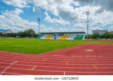 running track with football field in the stadium