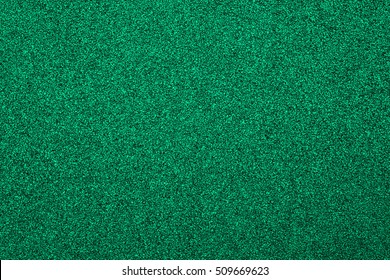 Running track green rubber cover texture for background. top view rubber running track texture