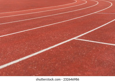 Running track lanes around the bend