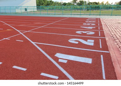 Running track over blue sky and clouds