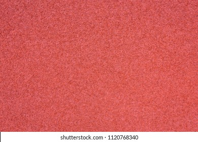 Running track red ground rubber cover texture background.