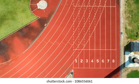 Running track at the stadium, color is orange brick, high angle view by drone.