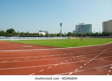 Running track in stadium. Running track on blue sky. field run in stadium background.