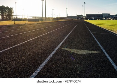 Running Track Sun Flare Arrow Lanes Black Turf Grassy Sports Field