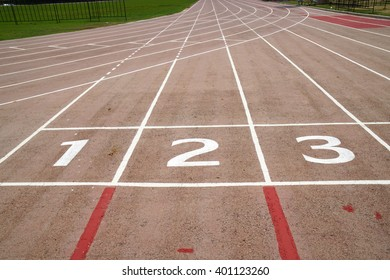 Running track texture with lane numbers, Old running track.