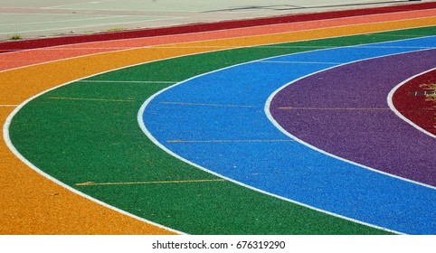 Running tracks in several bright colors with white lane markings