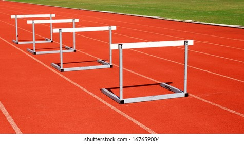 running tracks with three hurdles set up for training