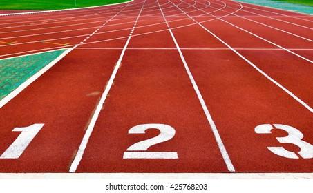 Running tracks with white start numbers