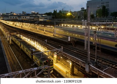 Running train and beautiful view of Ueno Station in the blue hour, Tokyo, Japan