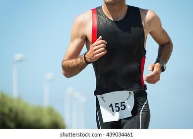 Running triathlon athlete man,running on triathlon race on sunny days