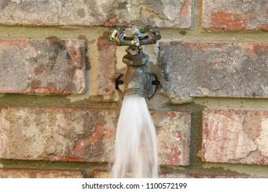 running water from outdoor faucet - spigot