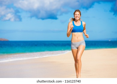 Running woman. Female runner jogging during outdoor workout on beach. Beautiful Fitness Model Outdoors.