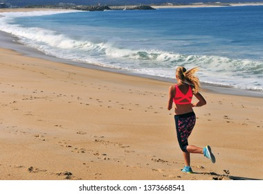 a running woman on the beach