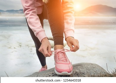 Running woman. Runner is jogging in winter day. Female fitness training outdoors