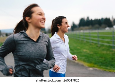 Running Women Jogging in Country