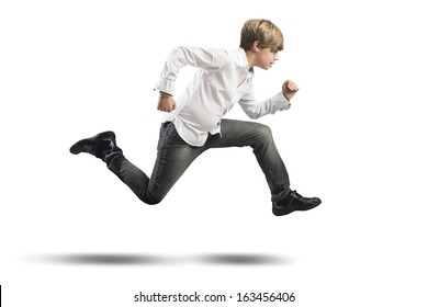 Running young boy isolated on white background