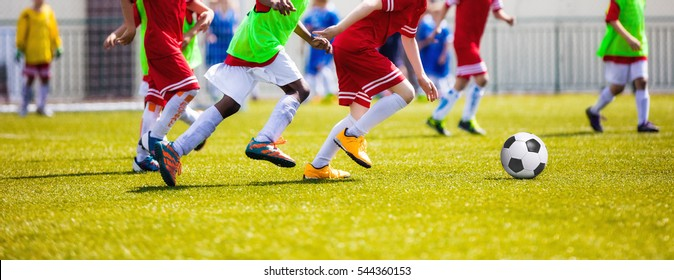 Running Young Soccer Football Players. Footballers Kicking Football Match Game. Youth Soccer Players Running After the Ball. Horizontal Football Stadium Background