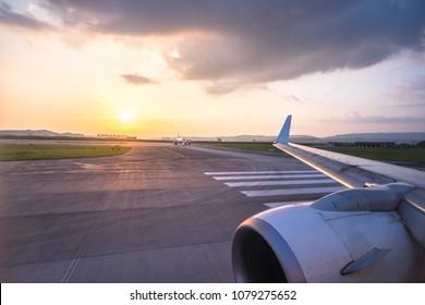 runway with airplane during sunset in chongqing jiangbei international airport