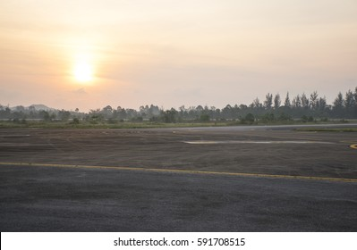 Runway airport in Morning. Sun on runway airport