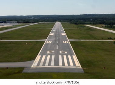 Runway approach at a rural airport in the eastern United States.