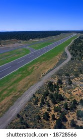 Runway from bird's eye view in helicopter with blue sky