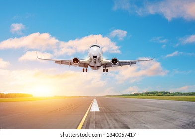 Runway clear for take off, airstrip with marking on blue sky with clouds background. Travel aviation concept.