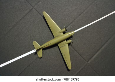runway military transport aircraft from above, miniature model