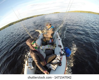 RUOVESI, FINLAND: JULY 9, 2019: fishing from a rafting boat in Finland, big beautiful lake and endless horizon, goPro snapshot