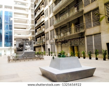 rupa solitare, mahape,navi mumbai,maharashtra/India- February 28th 2019 : office building complex with open area sitting arrangement and small budhdha statue.