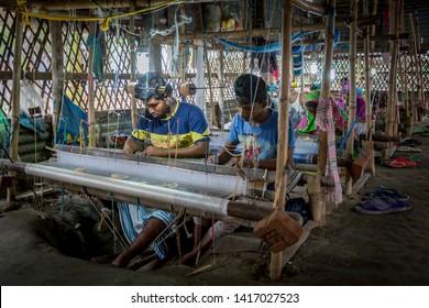 Rupganj, Dhaka Division, Narayanganj District, Bangladesh - 6th March, 2017. Handloom weavers creating world famous dhakai jamdani muslin sarees using cotton and gold threads.