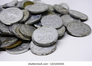 Rupiah coins on white background