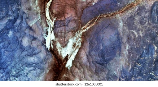 the rupture, tribute to Pollock, abstract photography of the deserts of Africa from the air,aerial view, abstract expressionism, contemporary photographic art, abstract naturalism,