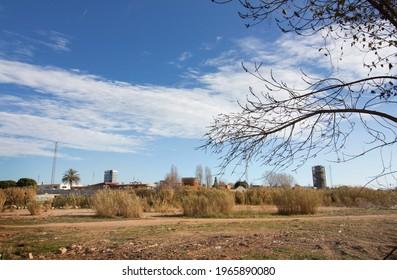 Rural area in Sant Boi de Llobregat overlooking the town of Sant Joan Despi, Baix Llobregat region, Barcelona, Catalonia, Spain. April 2021.