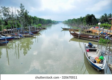 Rural asian fishing boat resting along the river